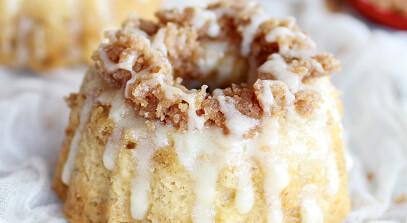 mini eggnog crumble bundt cakes with eggnog mascarpone glaze