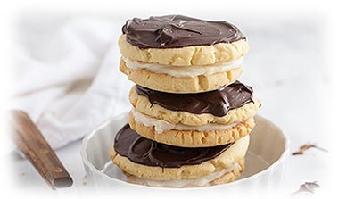 chocolate frosted orange cookies with creamy filling