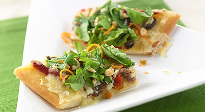 White Anchovy Coca Flatbread with Gran Canaria, Chopped Arugula, Almonds, Orange Zest and Extra Virgin Olive Oil