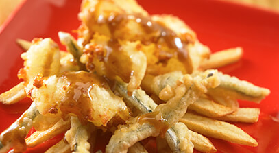 White Cheddar Poutine with Tempura Peppers and Piloncillo-Harissa Sauce