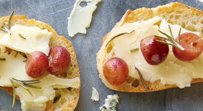 Roasted Grape and White Cheddar Crostini