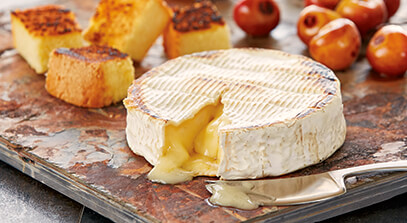 Slate-Grilled Camembert with Cherries and Honey