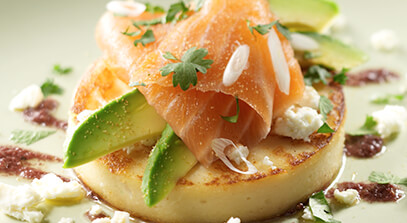 Warm Chickpea Pancake with Feta Cheese, Smoked Salmon, Avocado Salad and Black Olive Oil