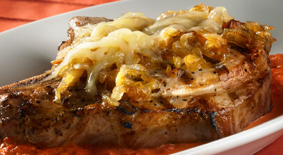Grilled Pork Chops with Caramelized Onions and Swiss Cheese