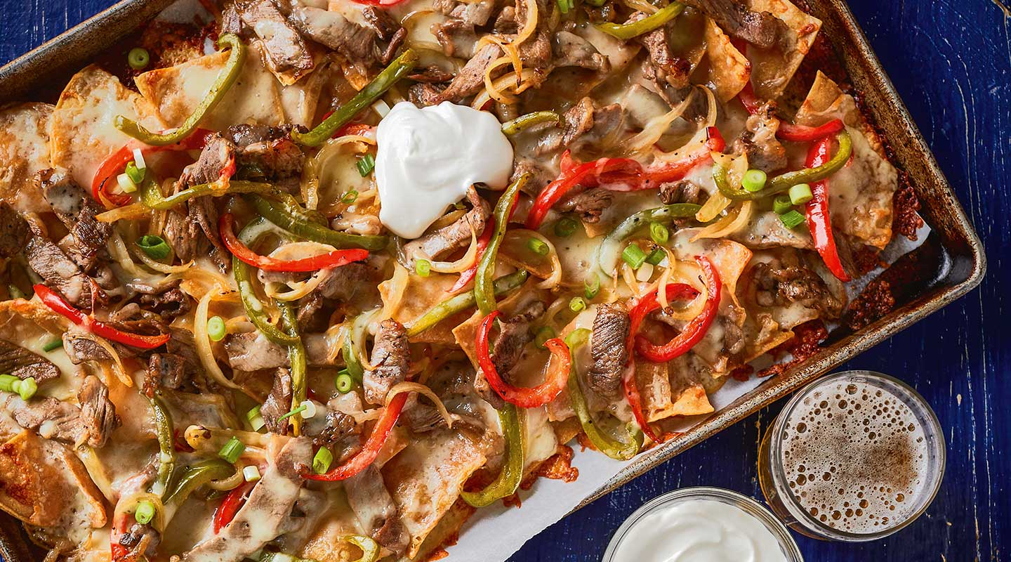Wisconsin Cheese Philly Cheesesteak Sheet-Pan Nachos Recipe