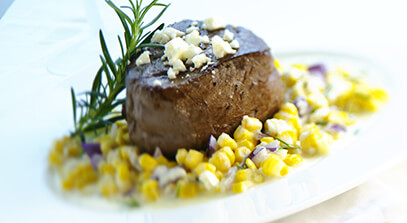 Grilled Beef Filet over Feta Creamed Corn