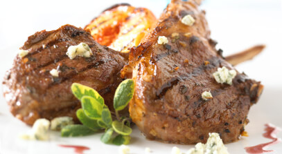 Sage and Canela Rubbed Lamb Chops with Grilled Peaches, Blue Cheese and Tempranillo Reduction