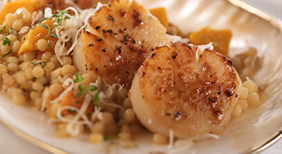 Pan Seared Sea Scallops with Israeli Couscous Risotto and Aged Parmesan