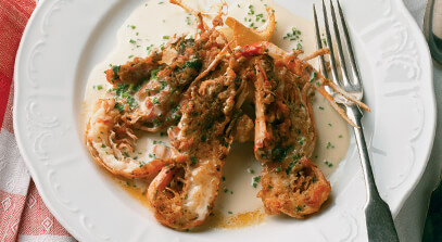 seared blue prawns provencal with crispy gorgonzola ravioli