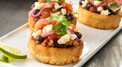 Black Bean Sopes with Queso Blanco, Cilantro, Lime and Pickled Red Onions