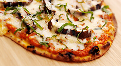 Flatbread Pizzas with Romesco Sauce, Portobello Mushrooms, Mozzarella and Smoked Gouda