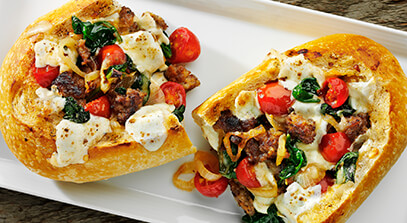 sausage and spinach french bread pizza with fresh mozzarella