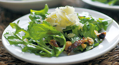 cheddar-blue salad with hazelnuts and dates