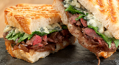 Grilled Skirt Steak Panini with Blue Cheese and Balsamic-Shallot Marmalade