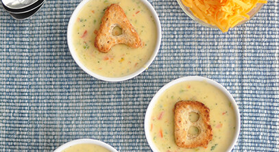 cheesy vegetable confetti soup with whole wheat alphabet croutons